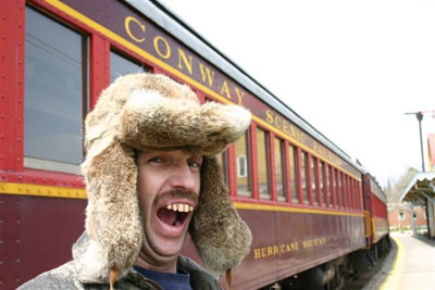 Bufford poses in front of the Conway Scenic Railroad Train