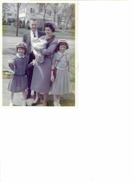 From left to right: the author at age 7, her  Dad,  Mom with  baby brother John and  sister Brenda.